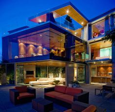 Modern cliff house above the ocean in southern California with glass walls, glass floor, large terraces and outdoor fireplaces.
