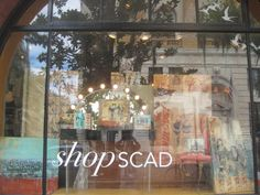 @shopSCAD window with #SCAD alums Melody Postma paintings and mixed media work by Molly Evans