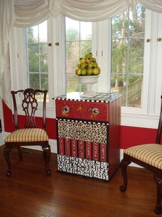 I can see scrapbook paper decopaged on the drawer fronts to give this look.  Easy peasy.