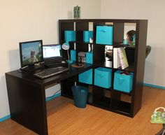Our new office using IKEA Expedit bookshelf as a room divider, desk on each side. Teal boxes are from Target (along with the waste baskets and lamps)