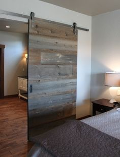 This is a really cool barn door. I like the how it is salvaged barn wood. I also like that it is on a sliding door track. This seems like it would be a good feature for a home to have. Reclaimed Wood Door, Wood Barn Door, Barn Door Hardware, Barnwood Doors, Wooden Doors, Sliding Bedroom Doors, Sliding Door Panels, Closet Doors, Entry Closet
