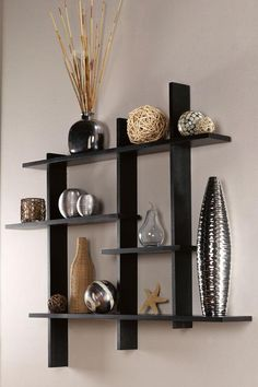 Contemporary Display Shelf:  The perfect solution for a large wall space.  If you already have a lot of framed prints and/or photo groupings in your home, this is the way to go.  I bought the smaller size in white for my upstairs hallway, which overlooks my foyer.  It looks great!