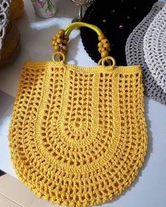 "New Cheap Bags. The location where building and construction meets style, beaded crochet is the act of using beads to decorate crocheted products. ""Crochet"" is derived fro Crochet Handbags, Crochet Purses, Crochet Shell Stitch, Crochet Stitches, Love Crochet, Bead Crochet, Purse Patterns, Knit Patterns, Crochet Market Bag"