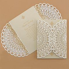 All the best of vintage romance. Laser-cut shimmer paper looks like a lace wrap around your wedding invitation. More shimmer is inside!