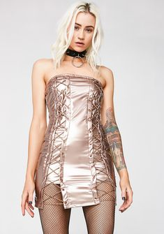 Rose Gold Come N' Get Me Vinyl Dress but be willin' to chase me. Keep em' on their toes with this strapless vinyl dress that has lace-ups on the front and a zip closure.