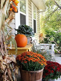 Looking for some fall porch inspiration? Whether you have a balcony, a wraparound porch, or just a small stoop, you can add fall touches to your space with pumpkins, mums, and cornstalks.