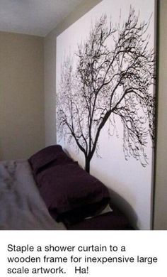 Put a curtain on a large canvas for a cheap