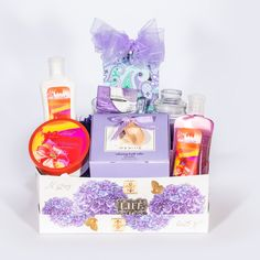 Pamper+Mom+Basket+-+This+spa+gift+basket+of+lavender-scented+bath+products+and+teas+will+rejuvenate+and+revive+even+the+weariest+wives+and+mothers.    This+Basket+Includes:  •	Dreamy+Blossom+Fragrant+Shower+Gel+10+oz.  •	Dreamy+Blossom+Fragrant+Body+Lotion+8+oz.  •	Dreamy+Blossom+Fragrant+Body+Butter+6.7+oz.  •	Bath+Massage+Gloves+-+Purple+(Not+Shown)+  •	Spa+Sister+Bath+Salts+-+Lavender+20+oz.  •	Lilac+Scented+Candle+in+glass+holder+2.5+oz.  •	Clear+Glass+Mug+8+oz…