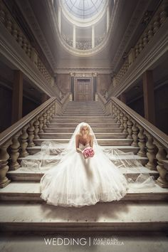 """WEDDING"" by Max Twain.     Fantastic wedding portrait and the lighting is superb. Composition with the steps leading towards the door works great!"