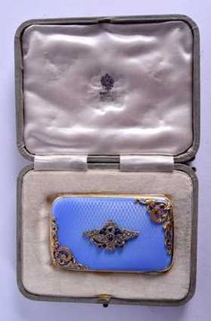 A RUSSIAN SILVER GILT AND ENAMEL CIGARETTE CASE