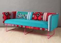 Handmade three seater sofa upholstered with colorful vintage Suzani, Thai Hmong and turquoise color velvet fabrics. The design is completed with