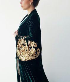 Qabeela's luxury evening abaya in silk velvet with intricate gold sequin detailing  Available online www.qabeela.biz