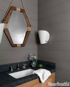 The wooden mirror with rope creates a subtle nautical theme here.