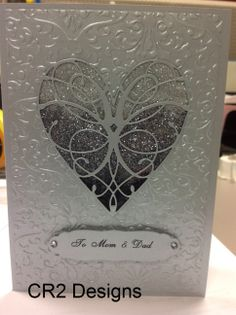 Here is the silver version of the Ombre Glitter Heart (cut from the #LaRue Heart by Memory Box). The embossing folder is by Darice. #memorybox