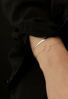 Modern gold bracelets for everyday layering by Vrai & Oro.