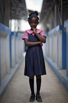 Nine-year-old Sarania Chida Cleon, who wants to be a nurse, stands outside rows of new classrooms at St. Gérard School in Port-au-Prince, the capital. The school was rebuilt after the original building collapsed during the 2010 earthquake – killing 27 students.  The new facility is earthquake- and hurricane-resistant and child-friendly. It is among 193 semi-permanent schools built with UNICEF assistance since the earthquake. - Haiti, 2011 © UNICEF/NYHQ2011-2215/Marco Dormino