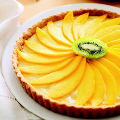 Looking for a spring tart dessert to make? Try this sprig-inspired mango tart. The perfect blend of sweet, exotic, and sour in a refreshing tart dessert. Mango Desserts, Spring Desserts, Mango Recipes, Tart Recipes, Just Desserts, Cooking Recipes, Spring Recipes, Fruit Recipes, Dessert Crepes