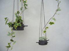 { Hanging Flower Pots by karin eriksson, via Flickr }