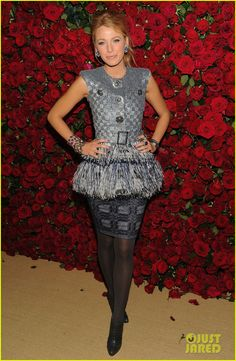 Blake wore a blue sequin embroidered vest and feather strapless dress from Chanel