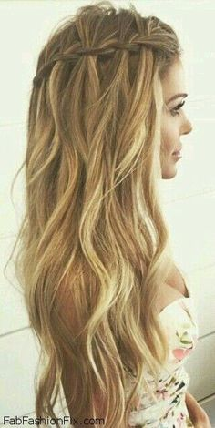 Loose waterfall braid for summer hair inspiration.