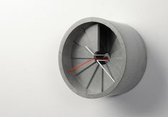 A wall clock made of cement. The form of the clock is like a spiral staircase, and the hands are on its top level.Light and shadow changes with time in this clock. The concept of Dimension Clock is to link time and space. Cement Walls, Concrete Wall, Concrete Design, Home Decor Accessories, Decorative Accessories, How To Make Wall Clock, Unique Wall Clocks, Staircase Design, Spiral Staircase