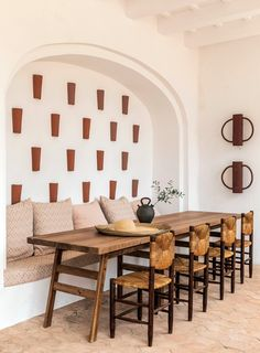 Two new hotels in Menorca that are making it the destination of the summer. Designed by Dorothee Melilizchon, the new interiors of Menorca Experimental combined terracota with beige and cream. A long wooden table with a built in bench in the wall. Menorca, Casa Hotel, Dining Chairs, Dining Table, Dining Room, Turbulence Deco, Interior Architecture, Interior Design, Interior Work