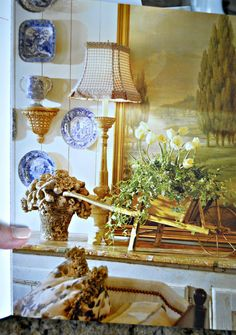 french romance ..(A small wooden wheel barrel is used indoors to hold a plant arrangement!)