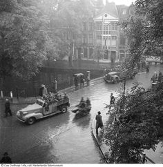 May 7, 1945. German soldiers leave Amsterdam after liberation of the city by Canadian forces. Photo NFA Nederlands Fotomuseum / Cas Oorthuys. #amsterdam #wordwar2