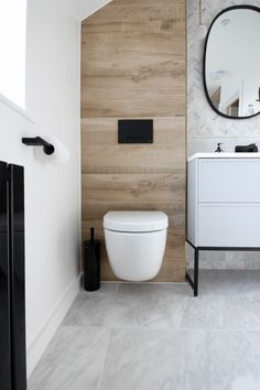 Minimalist Modern Marble and Wood small ensuite Bathroom with Black Accents