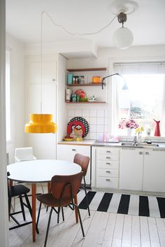 I like the black and white striped rug. It gives the same effect as a black and white checkered floor.