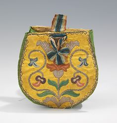 Pouch, 1730–60, Russian, silk, metal.   This is a particularly well-preserved object, retaining the original drawstring and loops. The embroidery is characteristic of the quality created in the 18th century and is heightened by the damask surface.