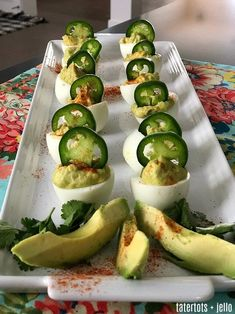 Spicy Avocado Deviled Eggs - a zesty twist on traditional deviled eggs! - Spicy Avocado Deviled Eggs are a zesty twist on traditional deviled eggs. Filled with creamy avocad - Jalapeno Deviled Eggs, Easter Deviled Eggs, Best Deviled Eggs, Deviled Eggs Recipe, Avocado Recipes, Egg Recipes, Appetizer Recipes, Appetizers, Easter Recipes