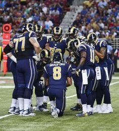 quarterback Sam Bradford calls a play during the first half against the Arizona Cardinals at Edward Jones Dome. Rams won 27-24. 9-08-13