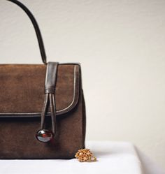 50's leather luxury handmade bag and '50s rhinestones ring.