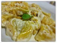 Tortelloni de alcachofa en salsa de nata y nueces