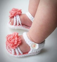 """These fashionable, summer baby girl shoes will make your baby little feet cozy and warm. This is fantastic gift for birthday, baptism or baby shower. Feature with salmon color flower in top and working buttons.  Booties crocheted with soft baby acrylic yarn. Designed and made by me.  Available sizes: 0 – 3 months: 8/9 cm (3-3,5"""" L) 3 – 6 months: 10 cm (4"""" L) 6 – 9 months: 11 cm (4,3"""" L) 9 – 12 months: 12 cm (4,7"""" L) Please contact me, if you would like a bigger size.  It takes 3 - 4 days..."""
