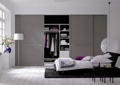 This modern closet door is a wonderful idea for your apartment. The grey color allows for a very neutral feel and the sliding door application allows you to save space. A wonderful bedroom decor inspiration, even for a smaller room. http://www.bartelsdoors.com/
