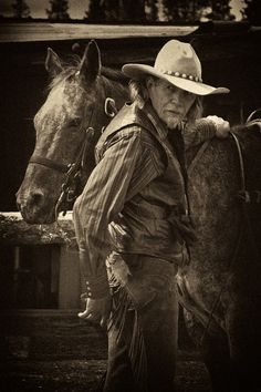 "Saddle up... , photo by Ted Ganiats.  Cowboy with ""Winnepeg"" at the Sunriver Stables in Eastern Oregon."