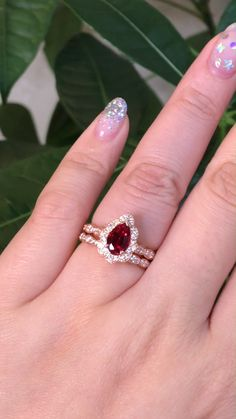 The perfect product of vintage style x pear shaped ruby, our Vintage Floral Pear Ruby Scalloped Bridal set! She's a vision in red ~ See more from the collection! ruby jewelry Lady in Red -- Vintage Floral Pear Bridal Set Halo Diamond Engagement Ring, Designer Engagement Rings, Diamond Wedding Rings, Vintage Engagement Rings, Vintage Rings, Ruby Ring Vintage, Vintage Jewellery, Antique Jewelry, Ruby Jewelry