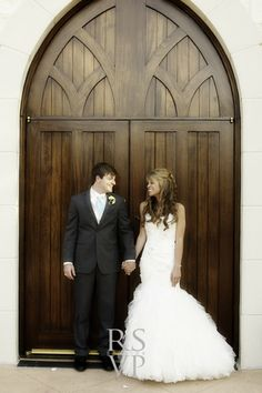 Adorable couple infront of our Chapel doors right after they shared there I do's !   Ashton Gardens - Houston,Tx