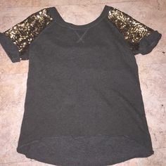 H&M army green shirt H&M army green shirt size small. with golden sparkled sleeves. lightly worn, extremely comfortable, and amazing fit! Price negotiable! H&M Tops Tees - Short Sleeve