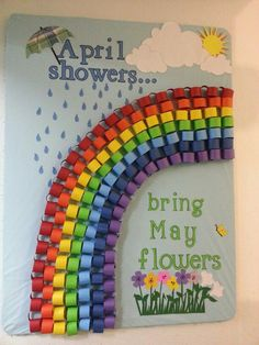 Pretty springtime bulletin board. April showers bring May flowers. I like the 3-D rainbow.