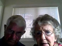 Cute old couple who can't figure out how to work the camera on their new laptop