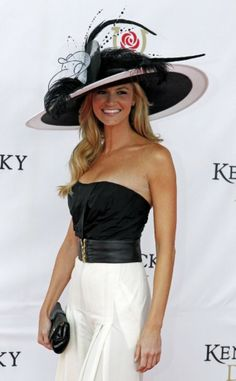 Sports reporter Erin Andrews arrives for the 137th Kentucky Derby horse race at Churchill Downs Saturday, May 7, 2011, in Louisville, Ky. (AP Photo/Darron Cummings)