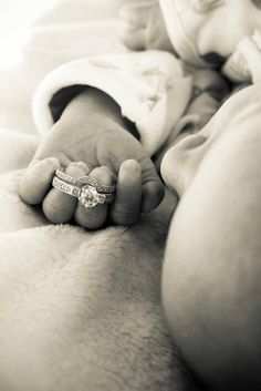 "Newborn and wedding ring! This would be cute framed with quote ""all because two people fell in love"""