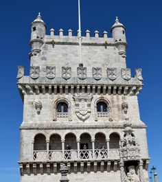 GOTHIC, Portugal - Belém Tower, Lisbon, 1513. Belém Tower is significant example of the Manueline style. The Manueline style is characterized by a rich and often fantastical use of ornamentation. Doors, windows and arcades are encrusted by elaborately carved stonework, in which the imagery of the sea; shells, coral, waves, fish, anchors, navigational instruments and cables mingle with the armillary sphere and the Cross of Christ.