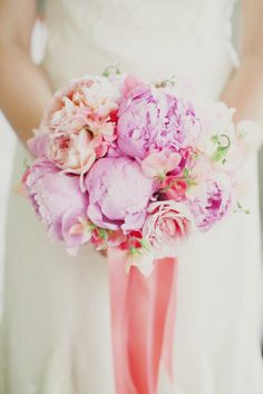 Purplish, pink and peach wedding bouquetBeautifully captured by Milou + Olin Photography