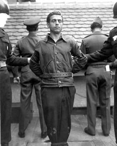 Anton Klein, a former guard at the Ebensee  concentration camp, moments before his execution by hanging in 1948. Note how the censor has whited out the face of the MP on the left and the decorations of the MP on the right. Ebensee was established by the SS to provide slave labor for the building of tunnels destined to store weaponry.