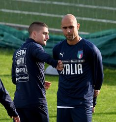 Marco Verratti (L) and Simone Zaza of Italy are joking prior to the training session at Italy club's training ground at Coverciano on November 7, 2017 in Florence, Italy. - 83 of 102