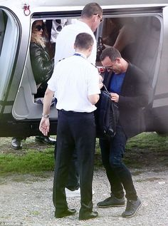Ladies first: Gentleman James allowed Mariah to get comfortable in the chopper while he checked in with the pilot